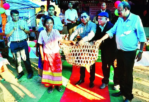 Fr Sunny (left) looks on as Chief Minister Mukul Sangma (right) presents the Chickens